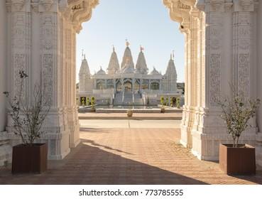 BAPS Shri Swaminarayan Mandir Houston. hindu religious temple in the city  in daylight blue sky .building sculpture  walls.symbolic house  hinduism.
