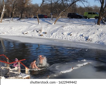 Baptism, bathing in the winter river. The Day of the Baptism of the Lord (or the feast of the Baptism of Jesus). 19.01.2014. Russia, the monastery of the Root Deserts in the city of Freedom,Kursk