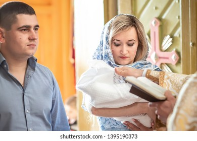 Baptism ceremony in Church. The sacrament of baptism. Attributes of an Orthodox priest for baptism. Child and God.