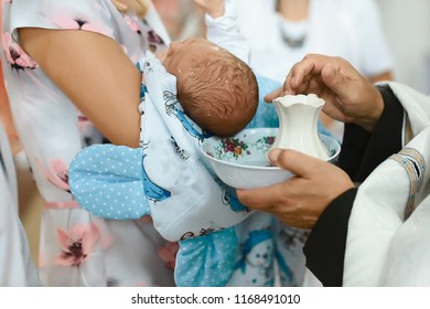 Baptism ceremony in Church, water pours on the head. Catholicism, the concept of Christianity. set