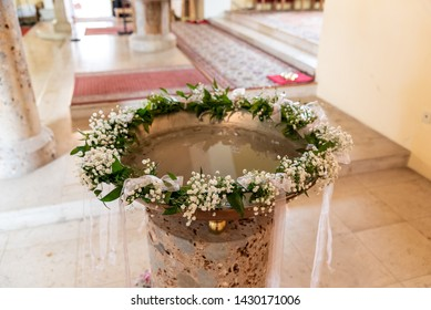 Baptism font with floral decoration