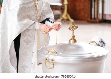baptismal font. Accessories for the christening of children icons of candles, the Ortodox Church.