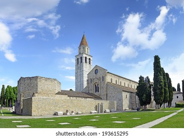 Baptistery of Bishop Chromatius and Basilica di Santa Maria Assunta and bell tower of Aquileia, Italy. Aquileia is UNESCO World Heritage Site