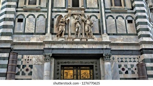 Baptizing. Architectural details of the Baptistery which is one of the oldest buildings in Florence. Iconic octagonal basilica with striking marble facade, known for its bronze doors. Italy, Florence