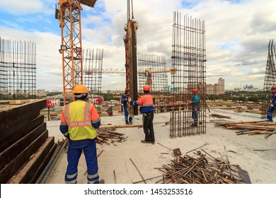 Bar bender fixing steel reinforcement for house concrete floor slab. construction worker Concrete pouring during commercial concreting floors of building in site and Civil Engineer. Moscow 06/2019.