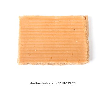 Bar of caramel isolated on white background