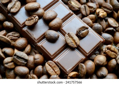 bar of chocolate and coffee beans