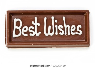 "A bar of chocolate inscribed with the words ""best wishes"", isolated on white"