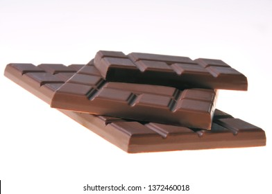 Bar of chocolate on a white background. Close-up