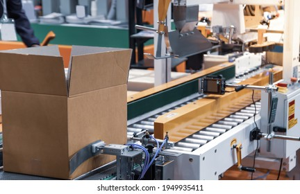 Bar code label scanner. Box identification with bar code scanner in modern industrial warehouse