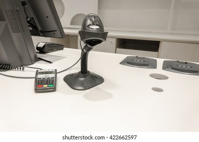 Bar code reader and the cards on the counter in the store