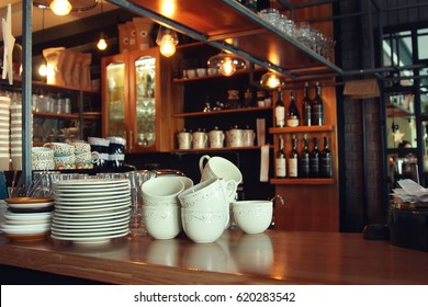 Bar counter with clean dishes in the cafe