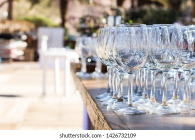 bar counter empty vine glasses outdoor exterior environment for some event, copy space