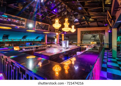 Bar counter wit reflection of lights in discotheque