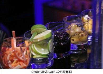 Bar garnishes lime rinds olives