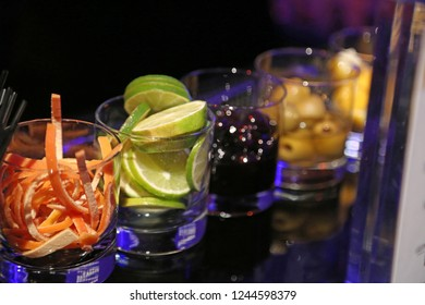Bar garnishes limes and rinds in focus