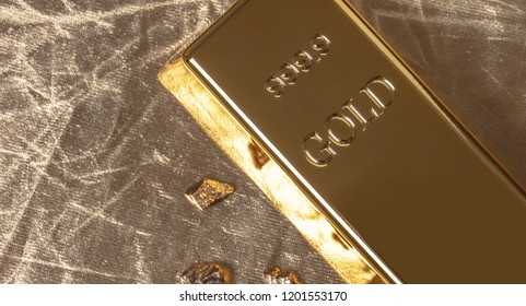 bar of gold close-up on golden background