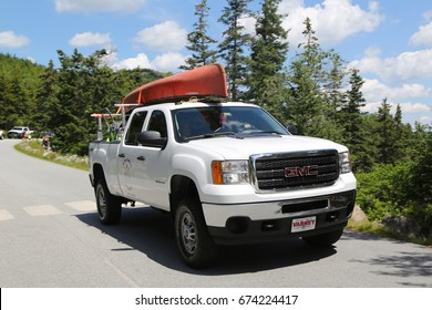 BAR HARBOR, MAINE - JULY 3, 2017: GMC truck loaded with kayak in Acadia National Park. Acadia National Park reserves much of Mount Desert Island in Maine