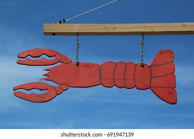 BAR HARBOR, MAINE - JULY 3, 2017: Sign in front of dockside lobster restaurant in historic Bar Harbor. Bar Harbor is a famous location in Down East Maine with a long history of lobstering
