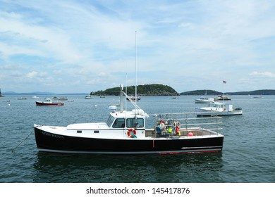 BAR HARBOR, MAINE - JULY 6: Lobster boats at Frenchman Bay near Bar Harbor, Maine on July,6, 2013.  Bar Harbor is a famous summer colony in the Down East region of Maine famous for lobster fishing