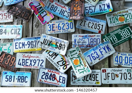 BAR HARBOR, MAINE - JULY 6: Old car license plates on the wall in Bar Harbor on July 6, 2013. In the U.S., where each state issues plates, New York State has required plates since 1901