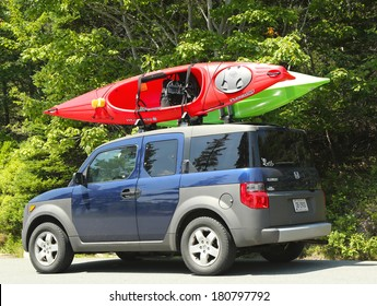 BAR HARBOR, MAINE - JULY 7  Honda Element minivan loaded with kayaks in Acadia National Park on July 7, 2013  Acadia National Park reserves much of Mount Desert Island in Maine