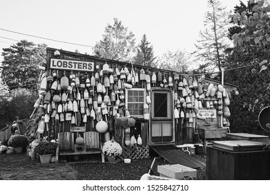 Bar Harbor Maine - September 28th, 2019: Lobster buoys and nautical decor at a local lobster pound in Bar Harbor at sunrise.  Black and white