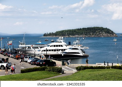 BAR HARBOR, MAINE, USA - AUGUST 6, 2010:  Nice day with blue sky in Bar Harbor with tourists visiting pier at Frenchman Bay in Maine.