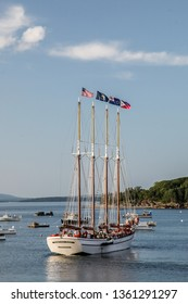 BAR HARBOR, MAINE, USA - JULY 6, 2013: Bar Harbor with schooner ``Margaret Todd`` with tourists for evening cruise.