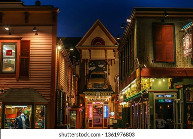 """BAR HARBOR, MAINE, USA - JULY11, 2013: Evening lights and building facade from """"Route US 66""""restaurant on Cottage Street."""