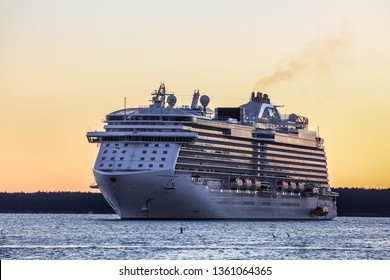 BAR HARBOR, MAINE, USA - OCTOBER 11, 2016: Regal Princess a Royal-class cruise ship operated by Princess Cruises is docking early morning in Bar Harbor