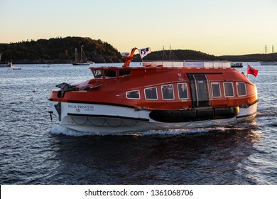 BAR HARBOR, MAINE, USA -  OCTOBER 11, 2016.: Small passangers boat from Regal Princess a Royal-class cruise ship operated by Princess Cruises early morning in Frenchman Bay, Bar Harbor.