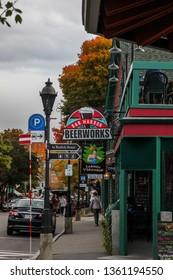 BAR HARBOR, MAINE, USA - OCTOBER,  13, 2016: Bar Harbor downtown during Autumn season, Main Street view and side walk.