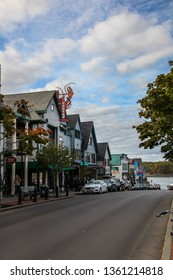 BAR HARBOR, MAINE, USA - OCTOBER 13, 2016: Bar Harbor Main street view with people enjoying autumn afternoon