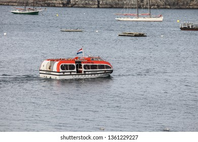 BAR HARBOR, MAINE, USA - OCTOBER 13, 2016: Bar Harbor  with smal tourist boat from cruise ship Zuiderdam from Holland American Line  with early afternoon lights during Autumn season