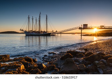 BAR HARBOR, MAINE, USA â?? October 5, 2016: Sunrise silhouette of schooner 'Margaret Todd' tied up at dock in Bar Harbor, ME.