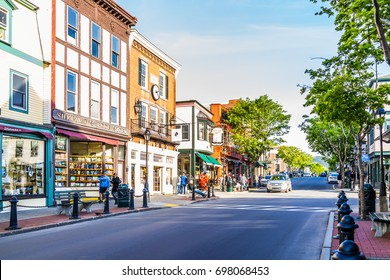Bar Harbor, USA - June 8, 2017: Empty main street in downtown village in summer with people and stores