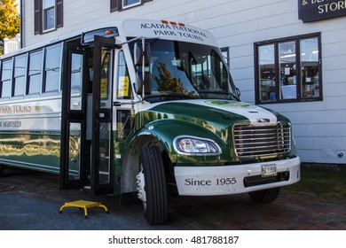 Bar Harbor, USA - October 15, 2015: Bus of the Acadia National Park Bus Tours waiting for passengers, the front door of the bus is open