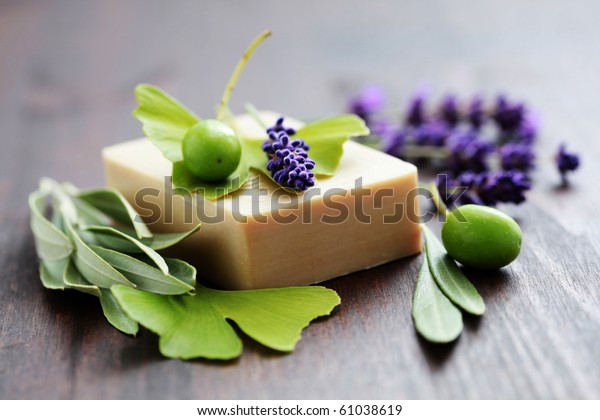 bar of herbal soap with fresh herbs and olives - beauty treatment