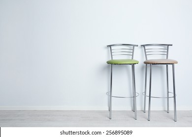 Bar high chairs on white wall background