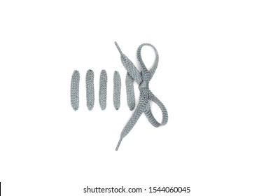 Bar lacing with a bow knot isolated on white background. Simple way to tie your shoes with silver shoelaces.