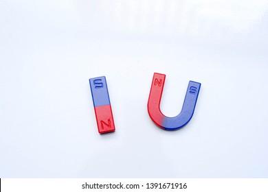 Bar magnet and horseshoe magnet over white background.
