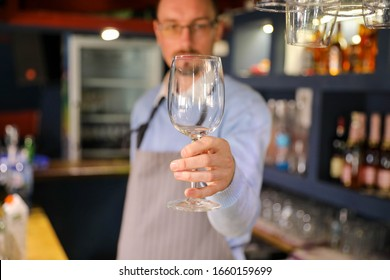 Bar Men with a glass in hand, close up