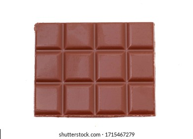 A bar of milk chocolate on a white background, isolate, the photo