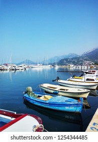 Bar,  Montenegro - Septembar 2, 2017. Colorful fishing boats on the background of mountains and yachts on the Adriatic coast.