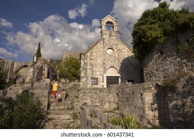 BAR, MONTENEGRO - SEPTEMBER, 18, 2016: Ancient stone ruins and serbian church on Old Bar town, Montenegro. Stari Bar - ruined medieval city on Adriatic coast, Unesco World Heritage Site.