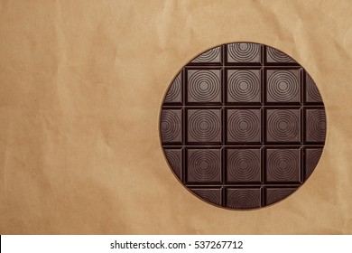 Bar of Round chocolate on old brown wrinkled paper. Pie chart concept