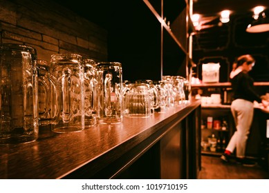 Bar shelf with empty beer glasses