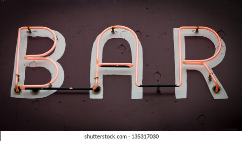 Bar Sign with glowing neon fluorescent letters on old grungy background texture