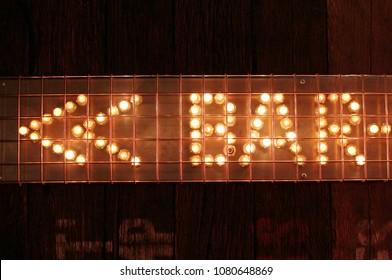 Bar sign lights with arrow